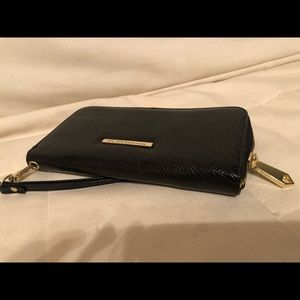 Black Zip-around BCBG wallet/wristlet